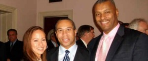 Arnold Cox and his wife Francis Morales with Massachusetts Govenor Deval Patrick